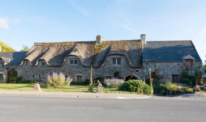 Old beautiful traditional stone house with thatched roof in Brittany not far from Mont Saint Michel. Normandy France