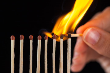 group of burn and unburned matches, isolated on black background