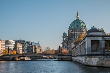 Poster Berlin Berlin Cathedral with Friedrichs Bridge over the River Spree. Historic arcade of the National Gallery. Sunny day at blue sky and buildings at the Spree shore