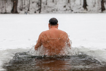Men Health life style concept. Winter Ice hole swimming.