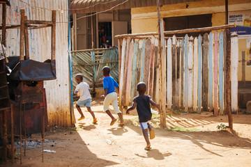 children running on the street in Uganda, Africa