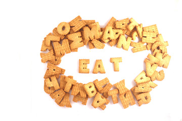 word EAT made of cookies isolated on white