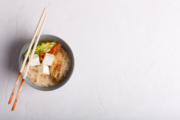 Traditional spicy asian soup with tofu cheese and noodles. White background