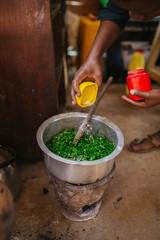 african woman cooking in Uganda