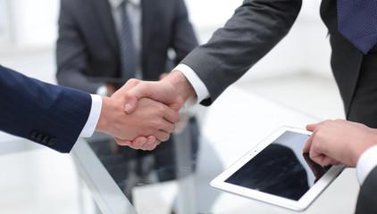 close up.financial partners handshake