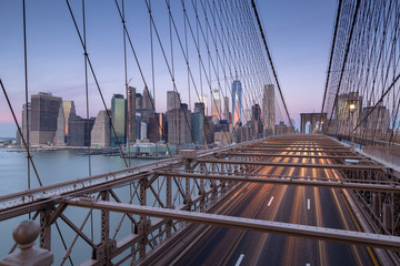 View from brooklyn bridge on Financial district at sunrise with long exposure