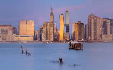 Midtown Manhattan Panoramic view from east river at sunrise with long exposure