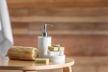 Obraz Composition with soap and toiletries on table against blurred background. Space for text - fototapety do salonu