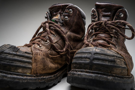 Studio shot of steel toed hiking boots on a grey background
