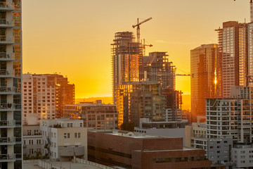 Sunset over Los Angeles California showing construction of skyscrapers