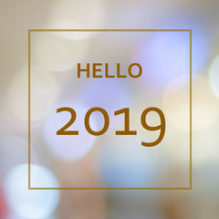 Hello 2019 on blur abstract bokeh background, new year greeting card, banner