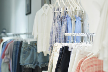 Racks with various clothes in fashion boutique