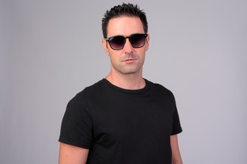Portrait of handsome man with sunglasses against white background
