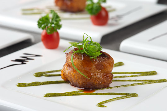 fried scallops wrapped with bacon , chinese dish