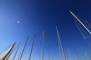 Abstract scenery of the clear blue sky that imaged the summer and the mast of the yacht