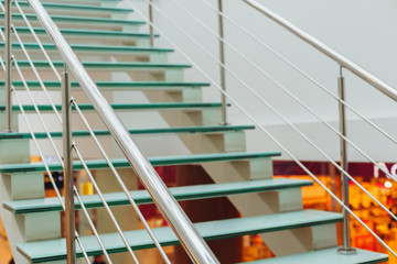 Design glass ladder with metal hand-rail in the trading floor of supermarket of the Watercolor shop, Volgograd