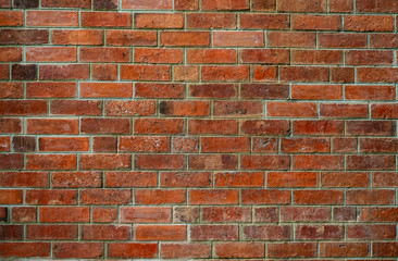 Orange brick wall texture background. Background for text. Exterior architecture concept. Dirty orange brick wall abstract background. Background for construction.