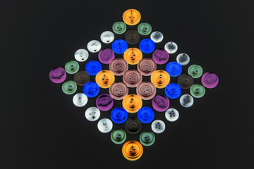 Collection of different buttons for clothes repair. Abstraction. Illustration. Set of colored buttons.