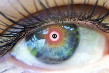 Eye of a man in a narcotic trance macro image of an expanded vision of the pupil blurred plan out of focus