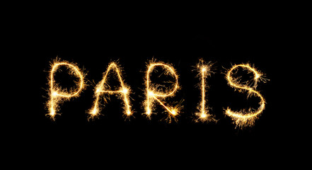 The city's name Paris is written in sparklers fireworks