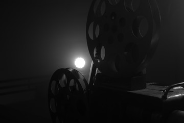 Vintage movie projector. Film reels. Black and white. Still life, close-up