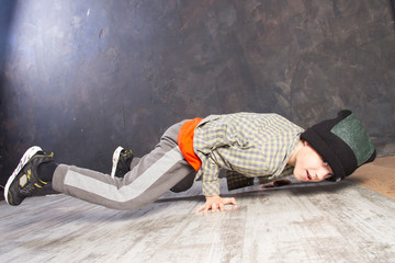 Young russian bboy doing some stunts on the stage