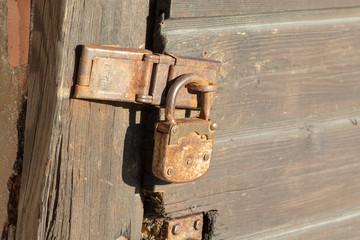 old rusty padlock on old door