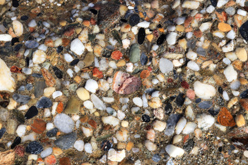Weathered sea concrete with lot of different pebbles texture. Nautical marine surface background.