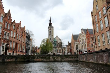 Bruges, Belgium. The Poortersloge view from boat trip in the canal of the city.