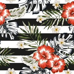 Tropical palm leaves, red hibiscus flowers, plumeria, striped background. Vector graphic seamless pattern. Jungle foliage illustration. Exotic plants. Summer beach floral design. Paradise nature