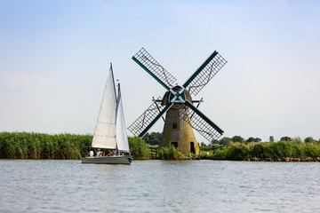 A sailboat and a Dutch windmill on the Kager Plassen