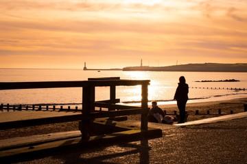 Meeting under a golden sunrise.