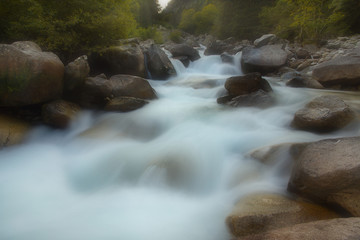 Mountain river cascading on the stones, long exposition, soft filter
