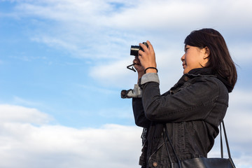 Chinese Girl Taking Picture With Her Photo Camera