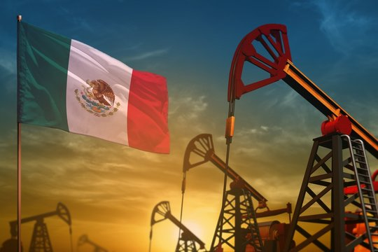 Mexico oil industry concept. Industrial illustration - Mexico flag and oil wells against the blue and yellow sunset sky background - 3D illustration