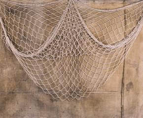 fishing net on dirty wall