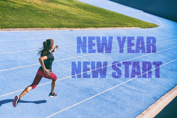 New Year resolution fitness concept. New Year New Start athlete runner sprinting on blue race tracks racing to the finish line in goal achievement challenge. Starting life change woman.