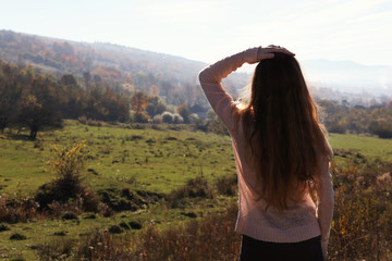 Female traveler viewing peaceful mountain landscape