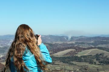 Professional nature photographer taking photo of mountain landscape