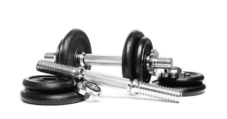 Professional dumbbell and parts on white background. Sporting equipment