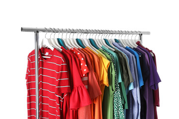 Wardrobe rack with different colorful clothes on white background