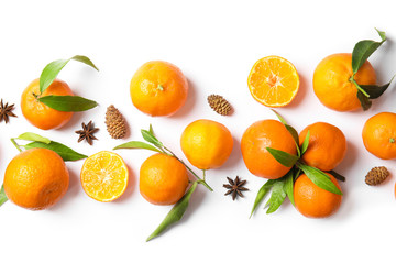 Christmas composition with ripe tangerines on white background, flat lay