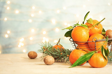Christmas composition with ripe tangerines on table. Space for text