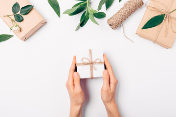 Woman's hands holding small gift box