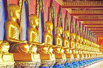 Golden  statues of Arhat / Arahant / or Buddhist saints at Wat Bang Thoeng, Krabi province, Thailand. Selective focus.
