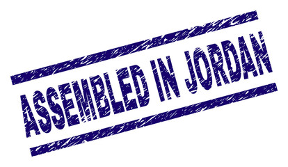ASSEMBLED IN JORDAN seal print with grunge style. Blue vector rubber print of ASSEMBLED IN JORDAN title with scratched texture. Text title is placed between parallel lines.