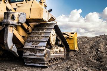 Obraz bulldozer moving dirt on the construction site - fototapety do salonu