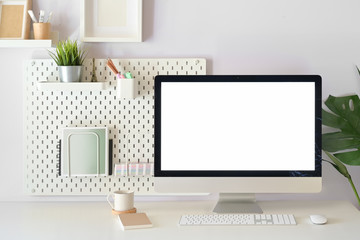 Modern home office, mockup blank screen desktop computer on white workspace