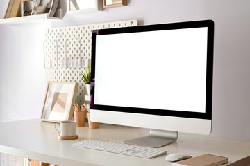 Modern home office, mockup blank screen desktop computer on white workspace