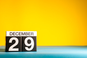 December 29th. Image 29 day of december month, calendar on yellow background with empty space for text